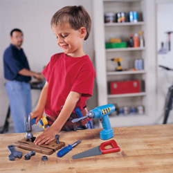 boy playing with pretend play tool set