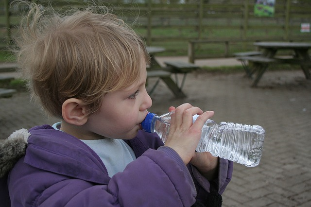 child drink water hydrate