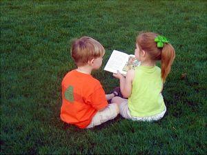 a boy a girl and a book