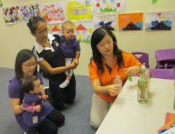 Teacher Jasmine (in orange) from LEAP Schoolhouse