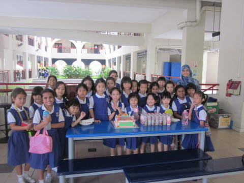 Liv, with her Teacher Mdm Hana and her classmates