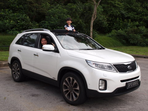 Mrs-Eng-and-Darius-in-their-Kia-Sorento-ride
