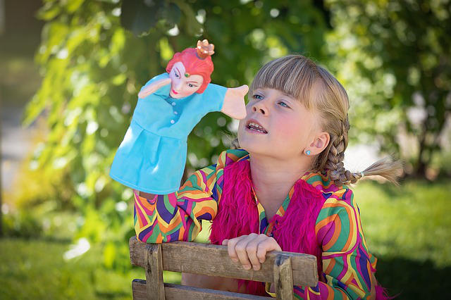 child playing with puppet