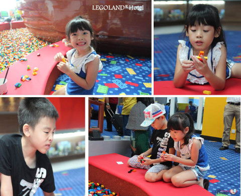 Ash Babies playing with legos