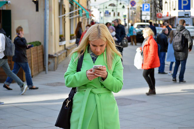 woman addicted to smartphone