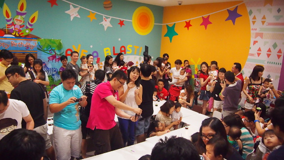 Parents gathered for a group birthday bash organised for their little ones