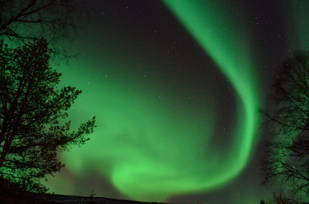 Strong, bright and vivid aurora borealis in the arctic winter
