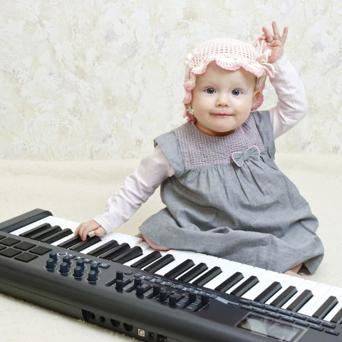 Baby girl posing with Electronic piano