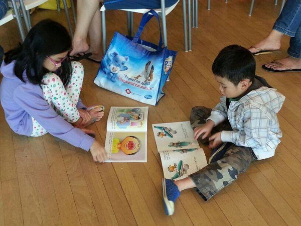 children reading the healthy smile series book