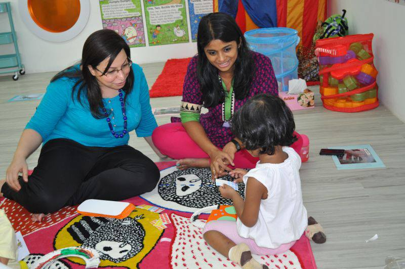Ms Pooja, with a parent at Kiddiwinkie SchoolHouse