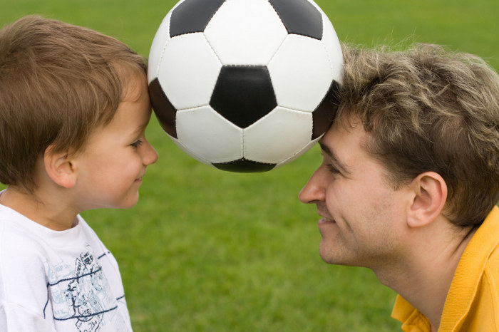 Father and son - Sunday soccer game portrait