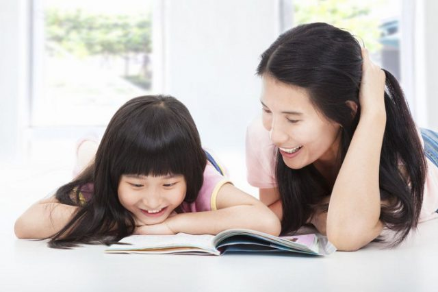 Daughter and mummy reading a book