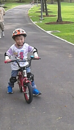 Boy learning how to ride a bicycle