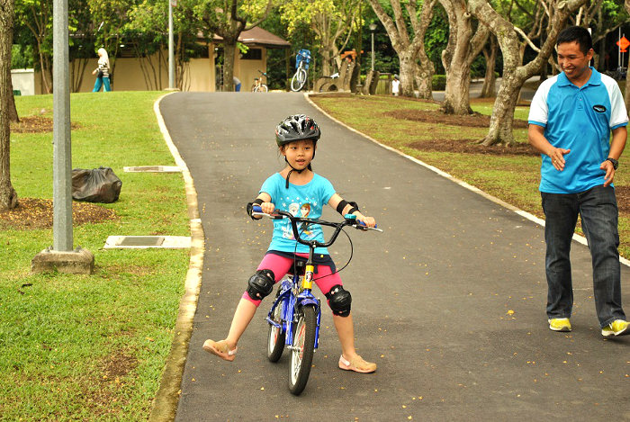 Child learning how to ride on a learner bicycle