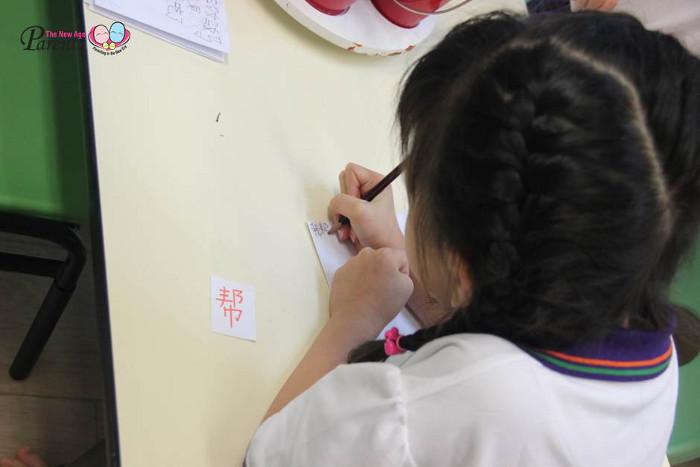 the little-skool house international - Girl is writing