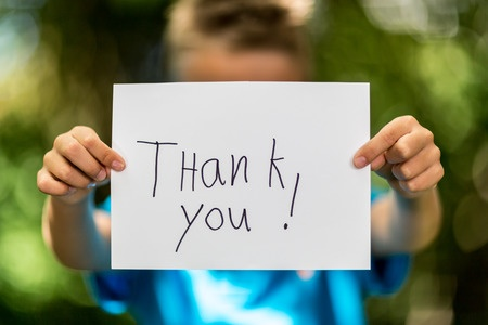 Boy holding thank you words