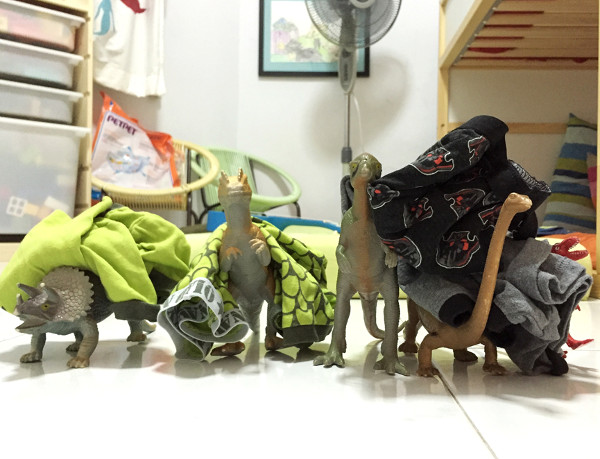 When Dinosaurs Come Alive At Night: Dinosaurs wearing PJs