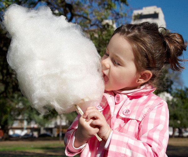child eating cotton candy
