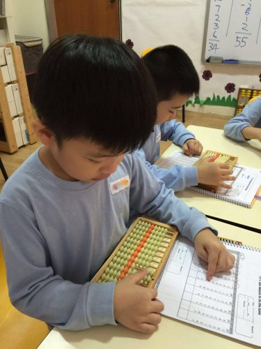 children in fun with abacus