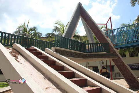 vintage pyramid and slide playground