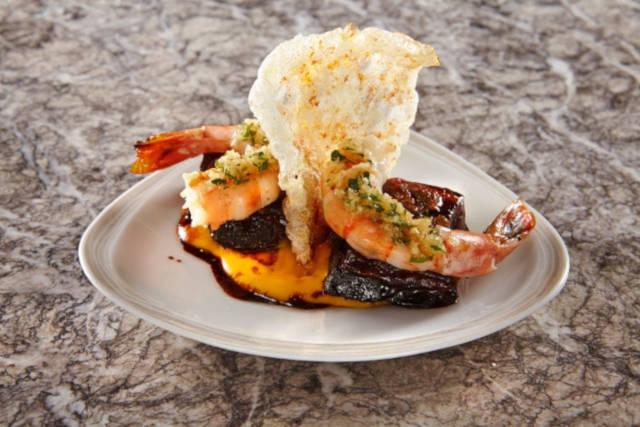 Caramelised pork belly grilled prawns sweet potato chorizo