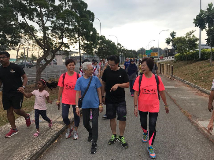 Desmond Choo walking with residents