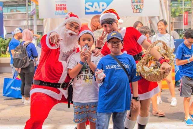 Having fun with Santa and Santarina Santa Run For Wishes