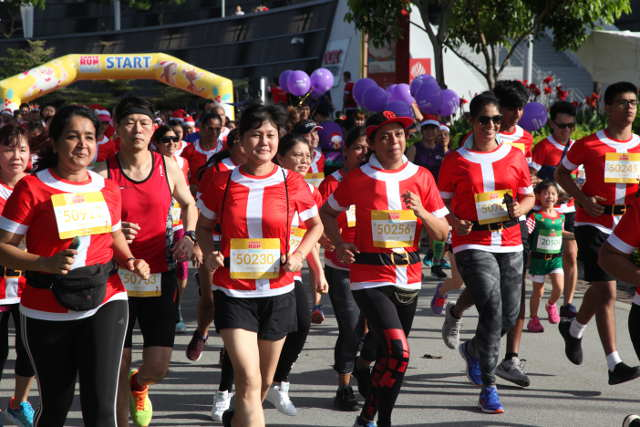 Santas and Elves running for a good cause Santa Run for Wishes