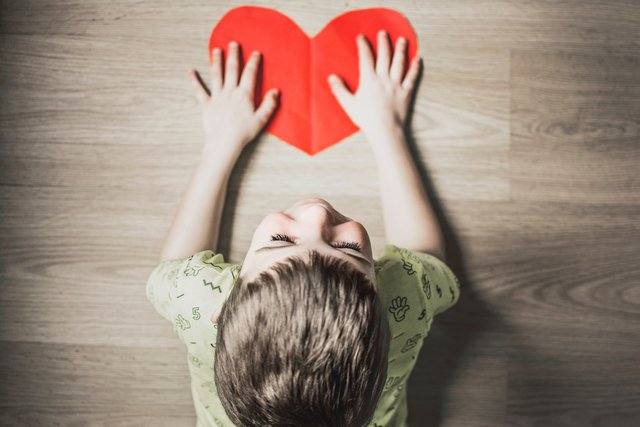 Child with heart symbol