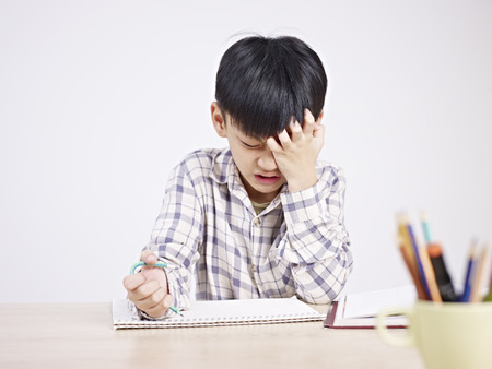 Boy frustrated while studying