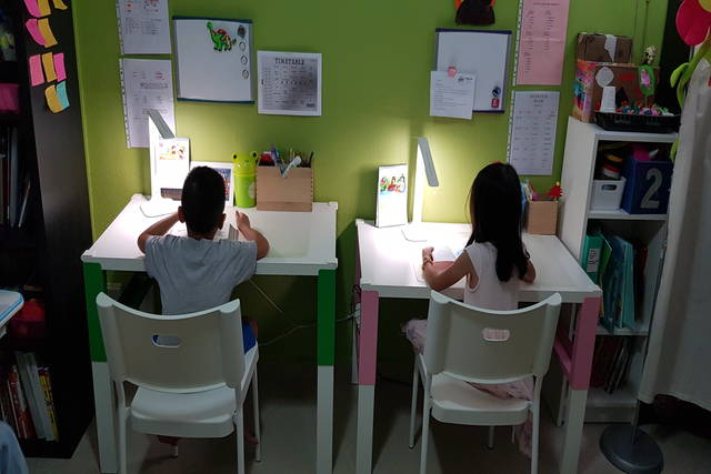 Children studying at desks