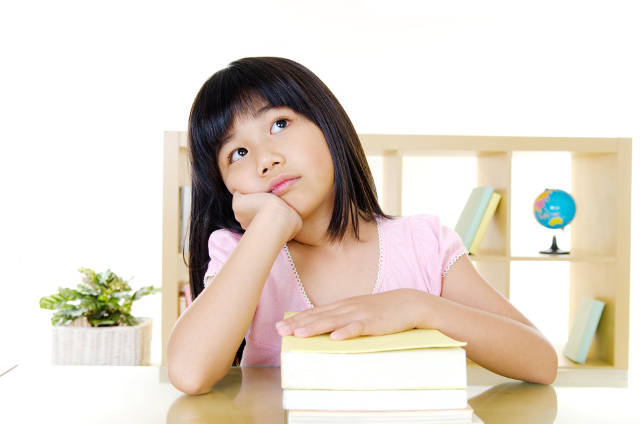 girl studying for psle exams