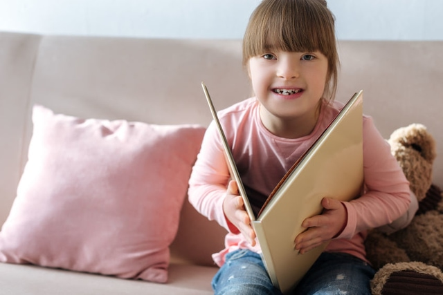 Kid with down syndrome reading