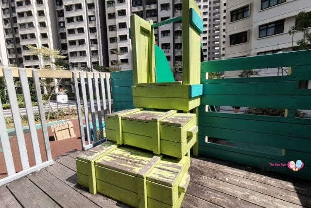 stacked crates to slide truck playground